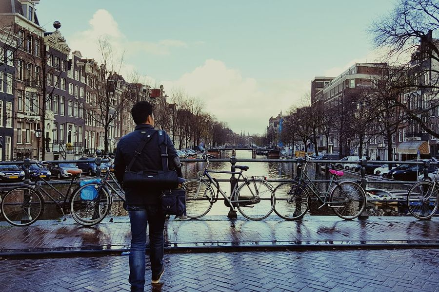 Amsterdam Traveling Bicycle Moving On Beautiful Town Canal Houses By Water Walking Travelphotography Behind You Follow You