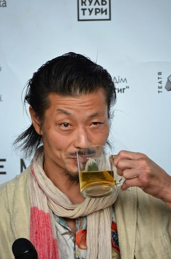 Portrait of mid adult man holding drink