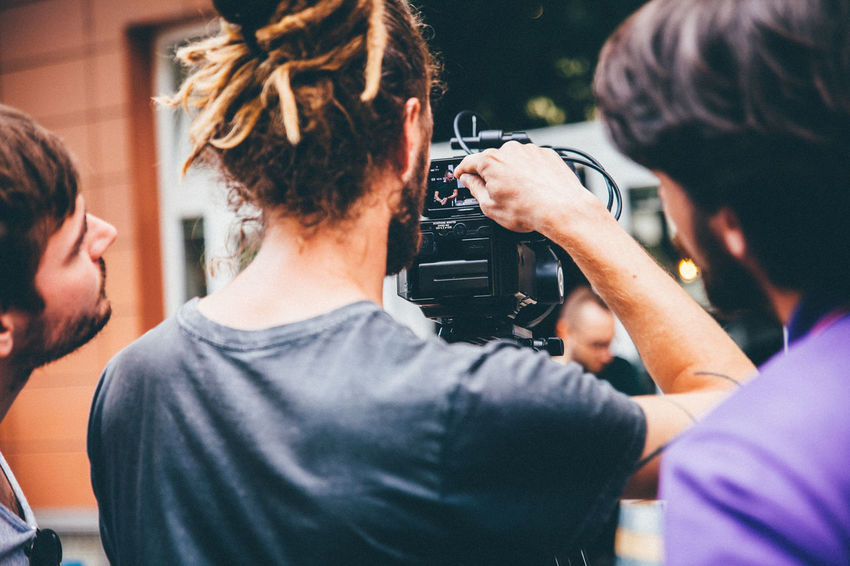 Camera - Photographic Equipment Filming People Real People Young Adult