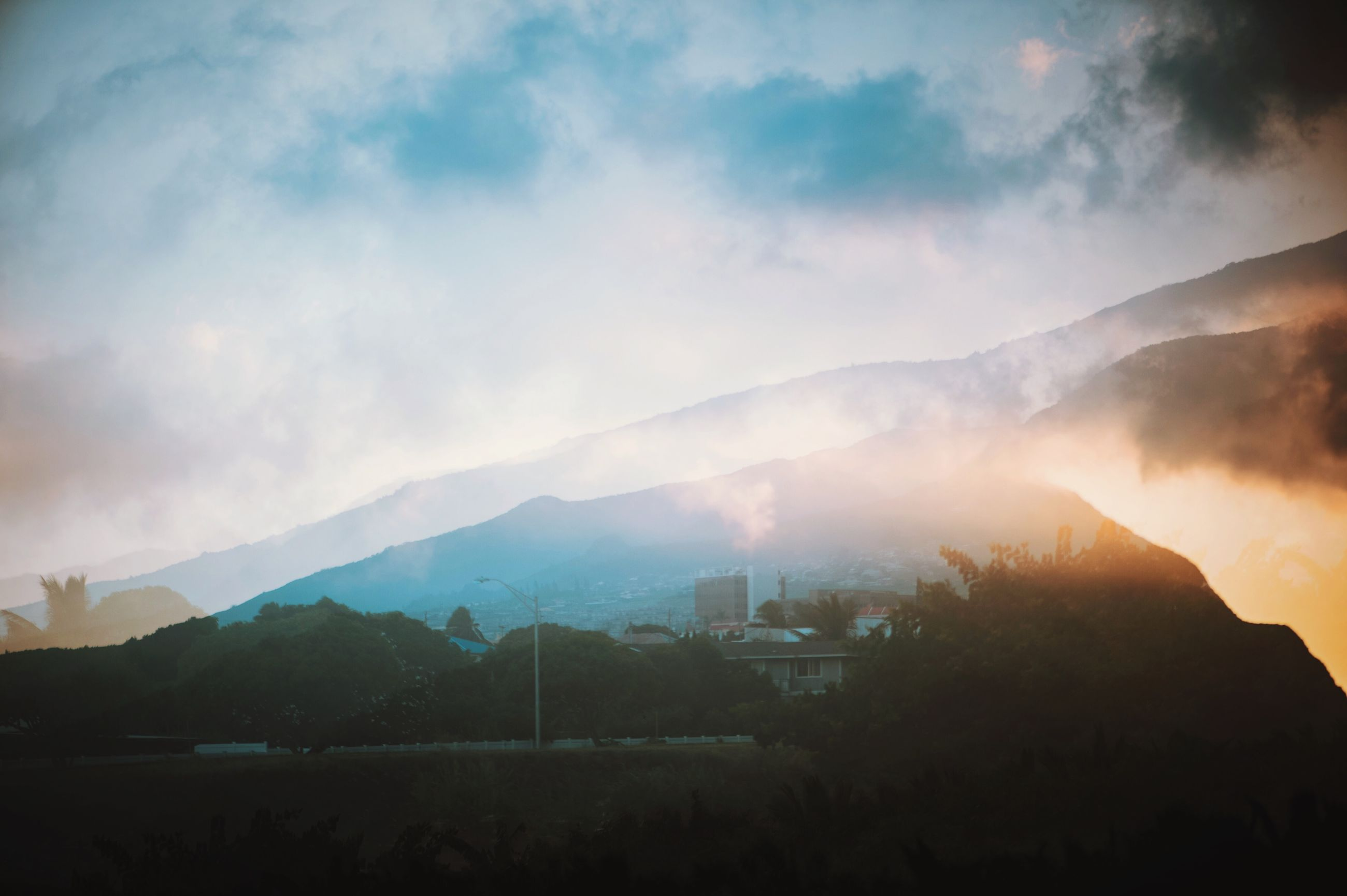 mountain, mountain range, sky, scenics, cloud - sky, beauty in nature, tranquil scene, tranquility, nature, cloudy, landscape, silhouette, weather, cloud, sunset, built structure, building exterior, dusk, architecture, idyllic