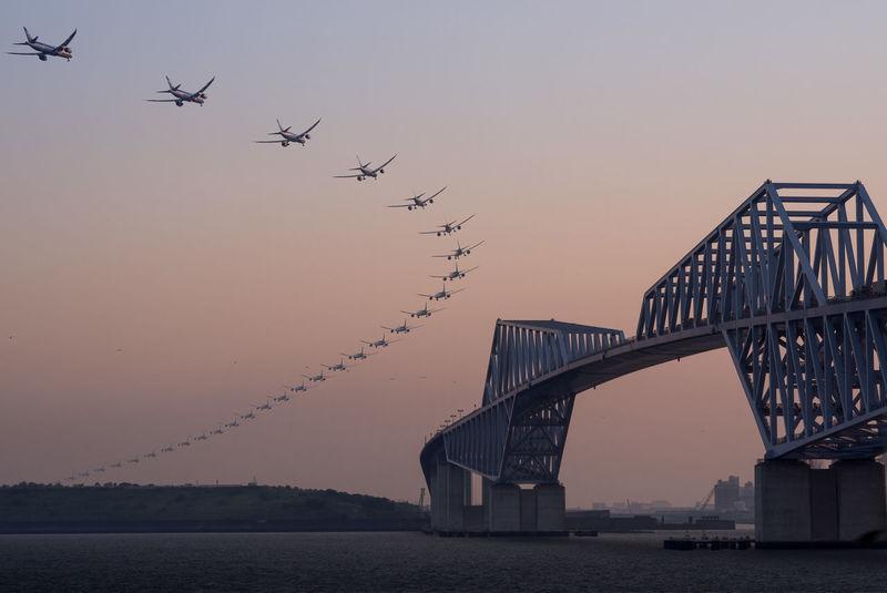 Landing Airplane Architecture Bridge Composition Continuous EyeEm Best Edits Flying Landing Motion Olympus Olympus Om-d E-m10 Transportation Twilight Twilight Sky