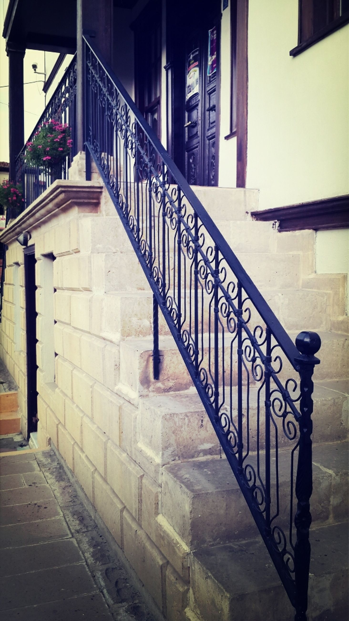 architecture, built structure, building exterior, railing, building, steps, staircase, residential building, residential structure, city, house, door, window, sunlight, empty, no people, steps and staircases, shadow, day, wall - building feature