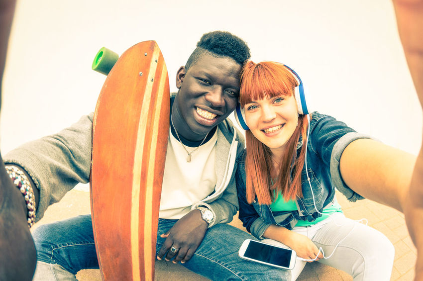 Hipster multiracial couple in love taking selfie on white background - Fun concept with alternative fashion and longboard item - Redhair girlfriend with afro american guy - Vintage filtered look Friends Friendship Multi Racial Multiracial  Multiethnic People Young Multicultural Teenagers  Teens Millennials Millennial Youth Connected Selfie Couple Love Fun Having Fun Social Media Social Network Story Skateboard Urban Vacation
