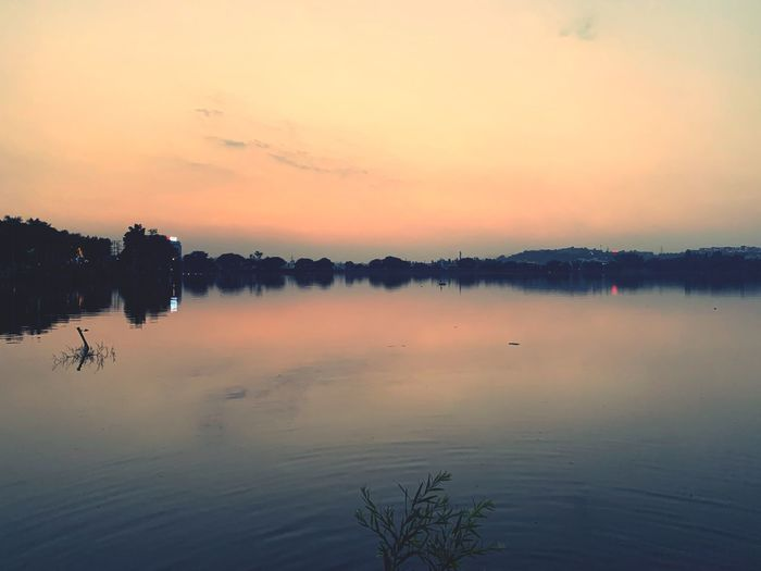 Fifty Shades of Dusk Orange Color Lake Nature Cloud - Sky Silhouette Waterfront Outdoors First Eyeem Photo