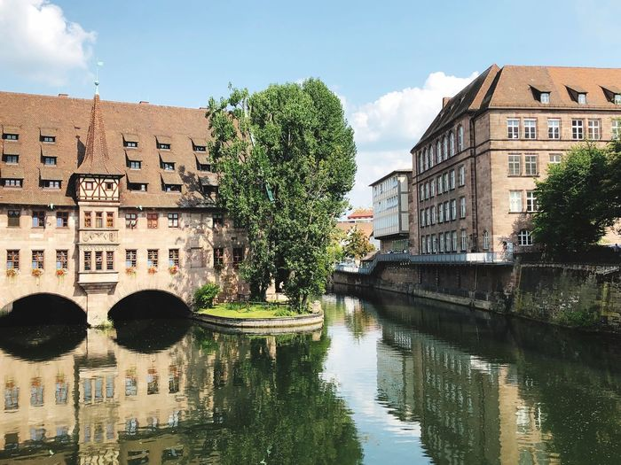 Nürnberg, Heilig Geist Spital Nürnberg Nuremberg Old Town Historical Buildings Nuremberg, Germany Architecture Built Structure Building Exterior Water Reflection Sky Building Nature City Plant Day Cloud - Sky Waterfront No People Canal Outdoors