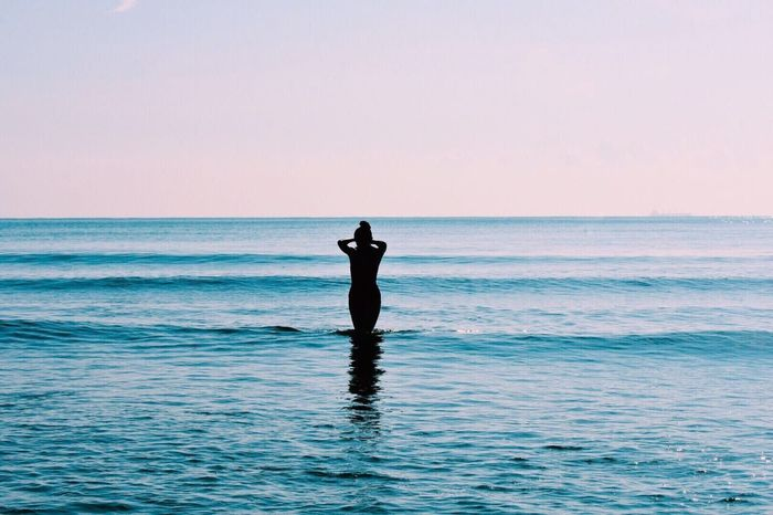 Sea Horizon Over Water Water One Person Real People Nature Tranquil Scene Silhouette Beauty In Nature Waterfront Scenics Standing Tranquility Outdoors Leisure Activity Lifestyles Sky Clear Sky Vacations People Lost In The Landscape