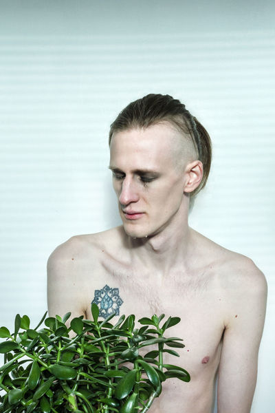 """""""The one who loves all intensely Begins perceiving in all living beings a part of himself."""" Front View People Only Men Leaf Headshot Plant Human Body Part Avantguarde Sadness Lonliness Love Crying Conceptual Portrait Eyes Closed  Succulents Man Fashion Social Issues Art Moodygrams Portraits People Photography EyeEm Selects"""
