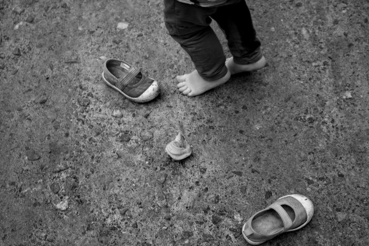 RainyDay Visual Creativity Childhood Day Lifestyles Muddy Outdoors Play Real People Shoe
