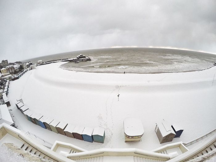 High angle view of sea against sky during winter