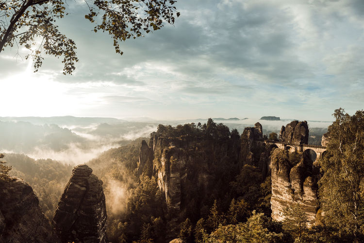Basteibridge in Saxony Switzerland in the eraly Morning Beauty In Nature Cloud - Sky Cloudy Landscape Mountains And Sky Nature No People Outdoors Rock - Object Sun Sunbeam Sunny Tourism Travel Destinations Tree