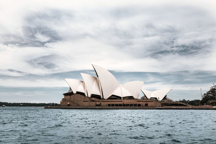 Cloud - Sky Water Sky Architecture Built Structure Building Exterior Waterfront Nature No People Day Travel Destinations River Outdoors City Transportation Rippled Travel Architecture Sydney Sydney Opera House Opéra Opera House Monument Australia Urbanphotography