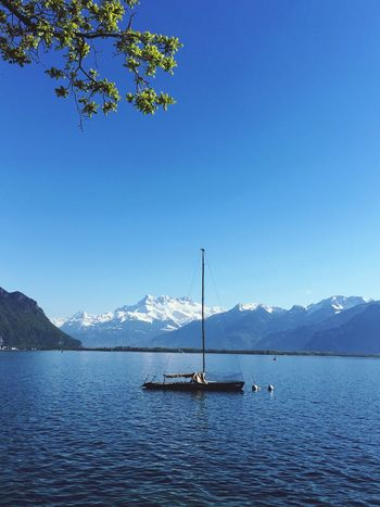 Mountain Nature Nautical Vessel Beauty In Nature Mountain Range Scenics Water Blue Tranquil Scene Tranquility Transportation Mode Of Transport Boat Lake Clear Sky Non-urban Scene Outdoors No People Sky Day