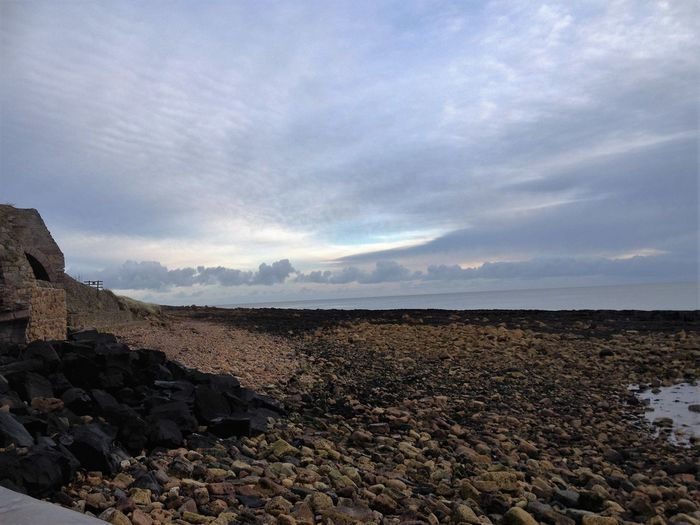 Beach Beauty In Nature Calm Cloud Cloud - Sky Cloudscape Cloudy Coastal Feature Coastline Day Dramatic Sky Nature No People Non-urban Scene Outdoors Remote Rock - Object Rock Formation Scenics Sea Shore Sky Tranquil Scene Tranquility Water
