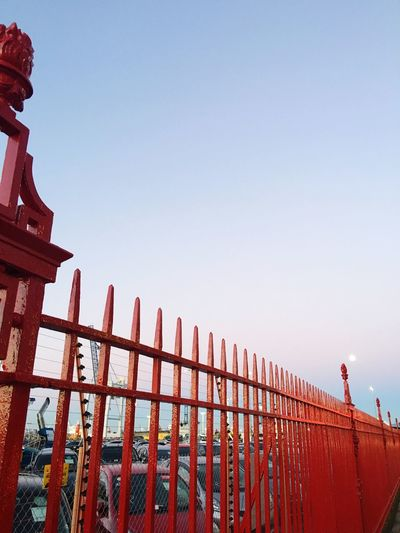 Red metal fence along the wharf Clear Sky Low Angle View Outdoors Red Fence Red Fence Metal Fence Wharf Moon