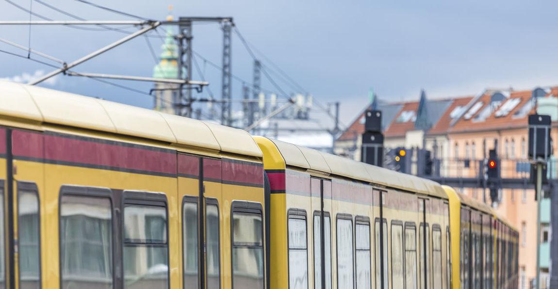 tram speeding in berlin germany Berlin Public Transportation Red Speeding Tram Tramonto Germany Real People Subway Train Train Station Yellow Yellow Color