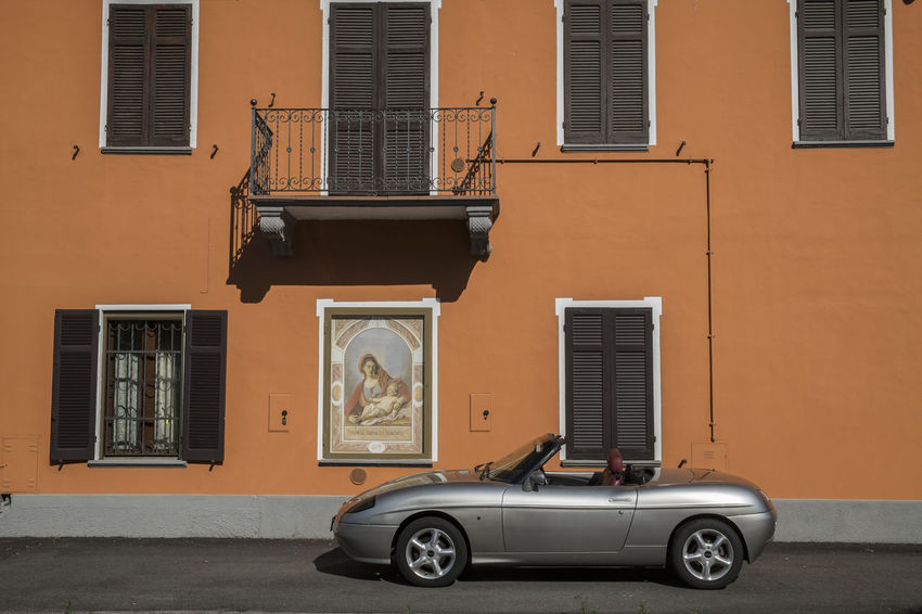 Fiat Madonna Architecture Barchetta Building Building Exterior Built Structure Car City Day Fiatbarchetta House Land Vehicle Mode Of Transportation Motor Vehicle No People Outdoors Parking Residential District Shutter Street Sunlight Transportation Window