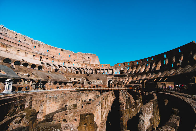 Coliseum against clear blue sky