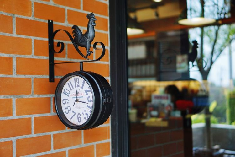 The clock in front of the cafe. EyeEm Selects Brick Wall No People Architecture Window Indoors  Time Building Exterior Day Built Structure Close-up Clock City Clock Face