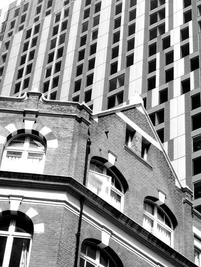 old meets new New And Old Contrast EyeEm Best Shots EyeEm Best Shots - Black + White EyeEm Selects Blackandwhite Atmospheric Mood Still Life Backgrounds Material Mix Shadows & Lights Full Frame Architecture Built Structure Building Historic Residential Structure Exterior Location Residential Building Office Building Human Settlement