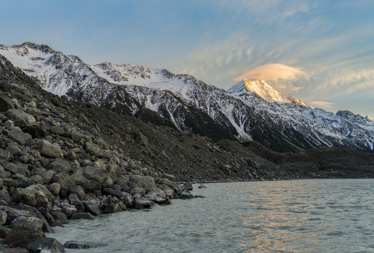 Clouds Above Mount Cook During Sunrise : Tasman Lake, New Zealand Beauty In Nature Cold Temperature Day Glacier Landscape Mountain Nature New Zealand New Zealand Beauty New Zealand Scenery No People Outdoors Scenics Sea Snow Snow Covered Snow ❄ Snowcapped Mountain Sony Sony A7 Sony Japan, Sony Malaysia Sunset Tasman Lake Water