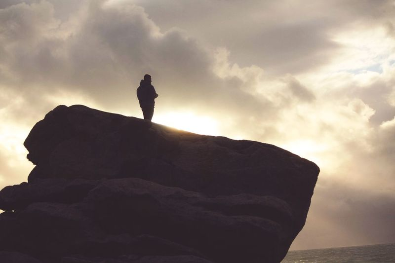 Little photography of a friend who happened to be on that rock. Sky Rock - Object Silhouette Nature Rock Formation Cloud - Sky Tranquility Outdoors Scenics One Person Tranquil Scene Adventure Sea