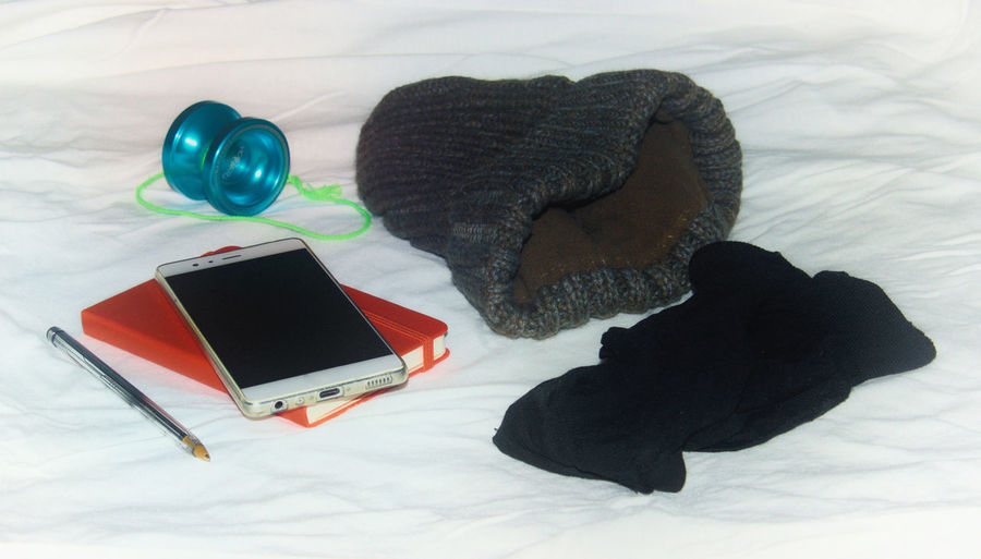 Travel essentials Composition Day Hanging Out Indoors  No People Pen Red Red Notebook Smartphone Socks Wool Hat Writing YoYo TK Maxx Socksie My Year My View