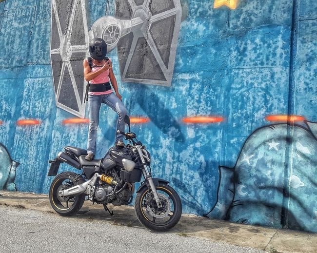 Fill your soul and body with positive energy, don't let anyone or anything steal your thunder 🤘😎💃🏍 One Person Woman On Bike Naked Motorcycle Women Driver Motorcycle Grafitti EyeEm Gallery Eye4photography  Futuristic Photography Edited Photooftheday Bday Photoshoot Transportation Day One Person Real People Wall - Building Feature Lifestyles Full Length Blue