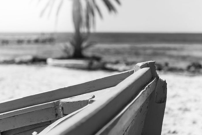 Front of a blue wooden boat on a sandy beach by the sea Beach Close-up Day Focus On Foreground Horizon Horizon Over Water Land Nature Nautical Vessel No People Outdoors Sand Scenics - Nature Sea Selective Focus Sky Tranquility Tropical Climate Water