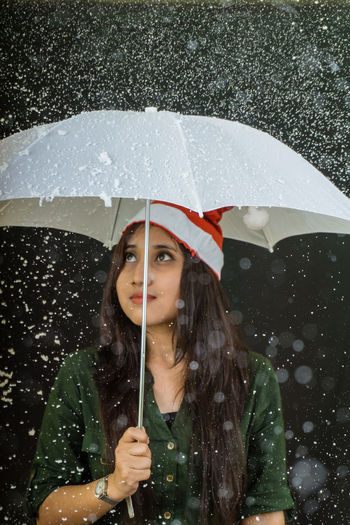 Christmas Portrait Of A Woman Adult Beautiful Woman Beauty Cold Temperature Day Drop Front View Lifestyles Motion One Person One Woman Only One Young Woman Only Only Women Outdoors Portrait Rain RainDrop Snowing Sony A6000 Storm Water Weather Wet Winter Young Adult Young Women