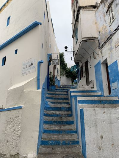 Low angle view of staircase amidst buildings in city