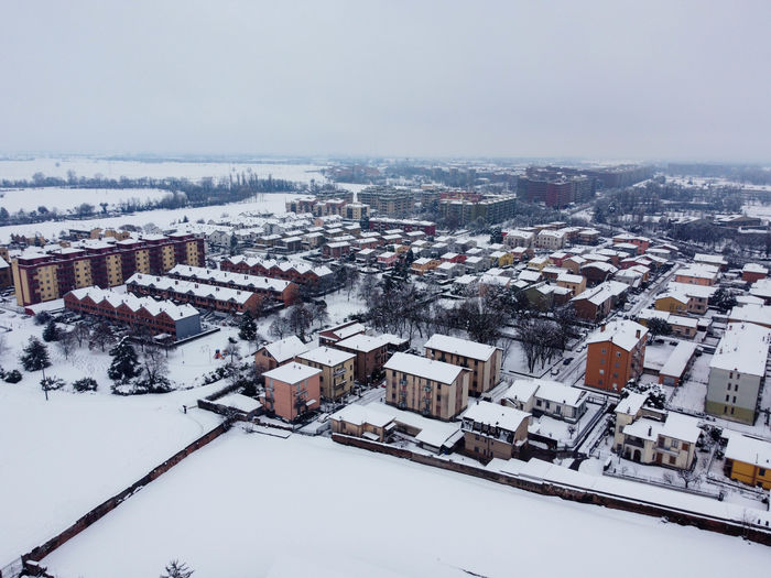 High angle view of snow covered buildings against sky
