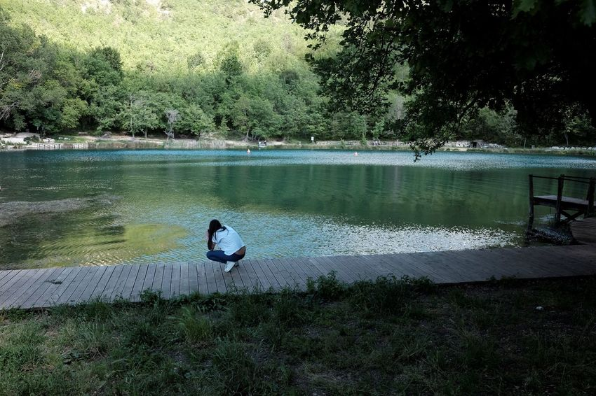 Beauty In Nature Day Growth Lake Nature One Person Outdoors People Perching Photographer Real People Sinizzo Tree Water