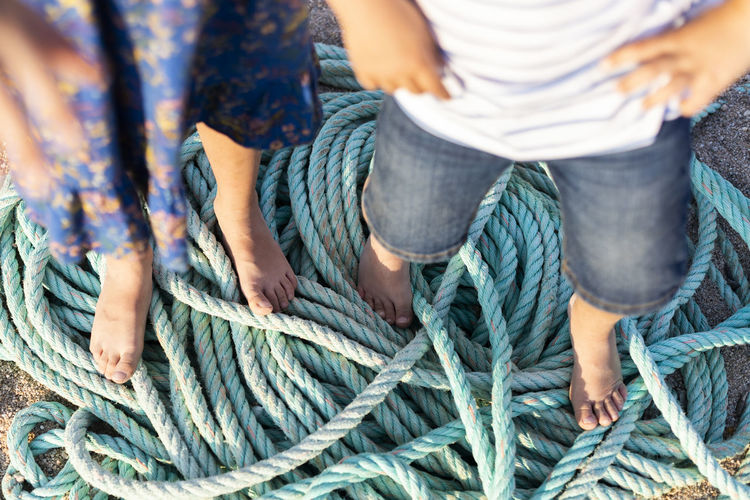 High angle view of friends tied up rope