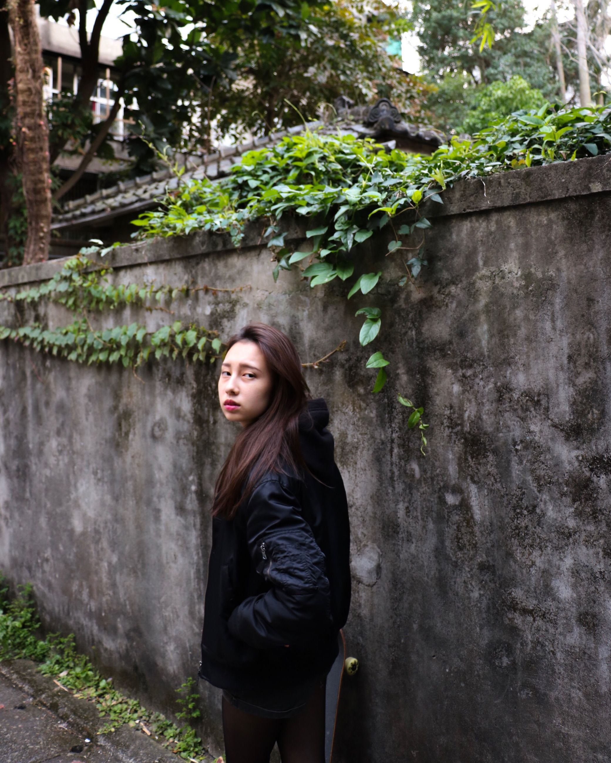 young adult, only women, beauty, one woman only, one person, one young woman only, contemplation, long hair, beautiful woman, beautiful people, adults only, plant, tree, young women, adult, people, green color, standing, real people, ethereal, nature, leaf, day, growth, beauty in nature, outdoors, warm clothing, human body part, long sleeved, lush - description, freshness