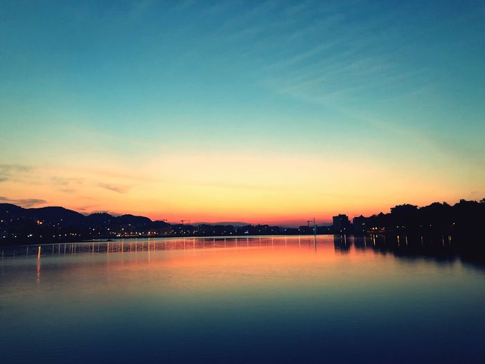Artificial Lake Of Tirana Lake Sunset Artificial Lake Sunset EyeEm Selects Water Sky Scenics - Nature Tranquility Beauty In Nature Sunset Waterfront No People Outdoors Illuminated Idyllic Silhouette Tranquil Scene Reflection Nature Lake Blue Orange Color Cloud - Sky