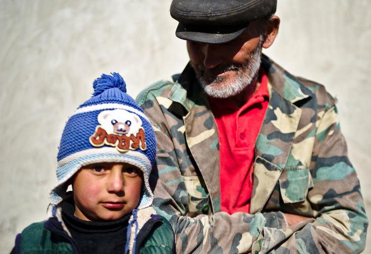 Portrait of boy wearing hat in winter