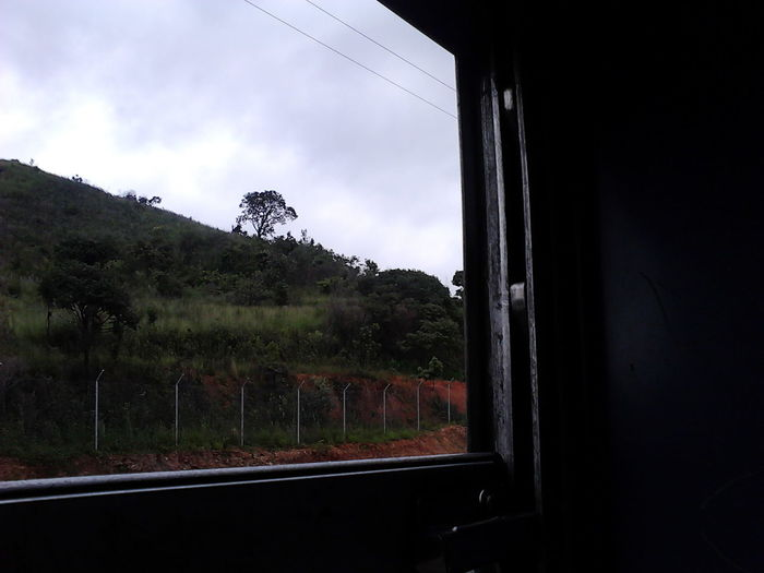 Jundiaí - São Paulo railroad Cloud - Sky Day Glass Glass - Material Indoors  Land Vehicle Mode Of Transportation Mountain Nature No People Plant Public Transportation Rail Transportation Sky Train Train - Vehicle Transparent Transportation Tree Vehicle Interior Window