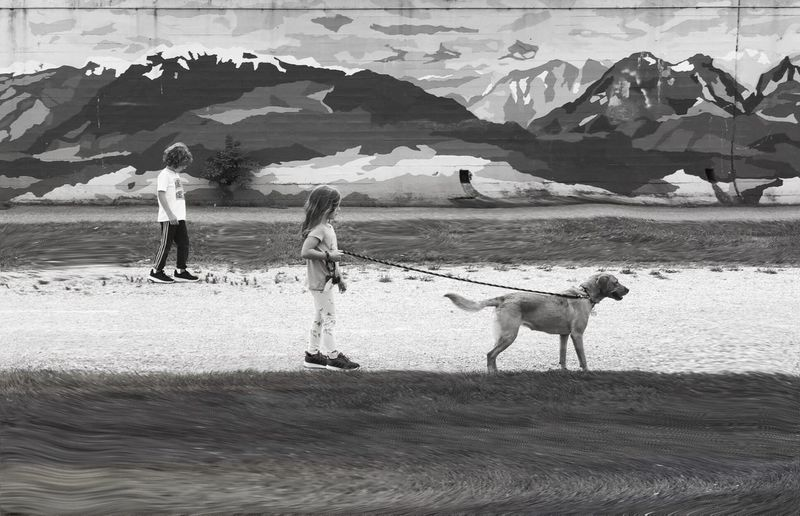 People with dog on land
