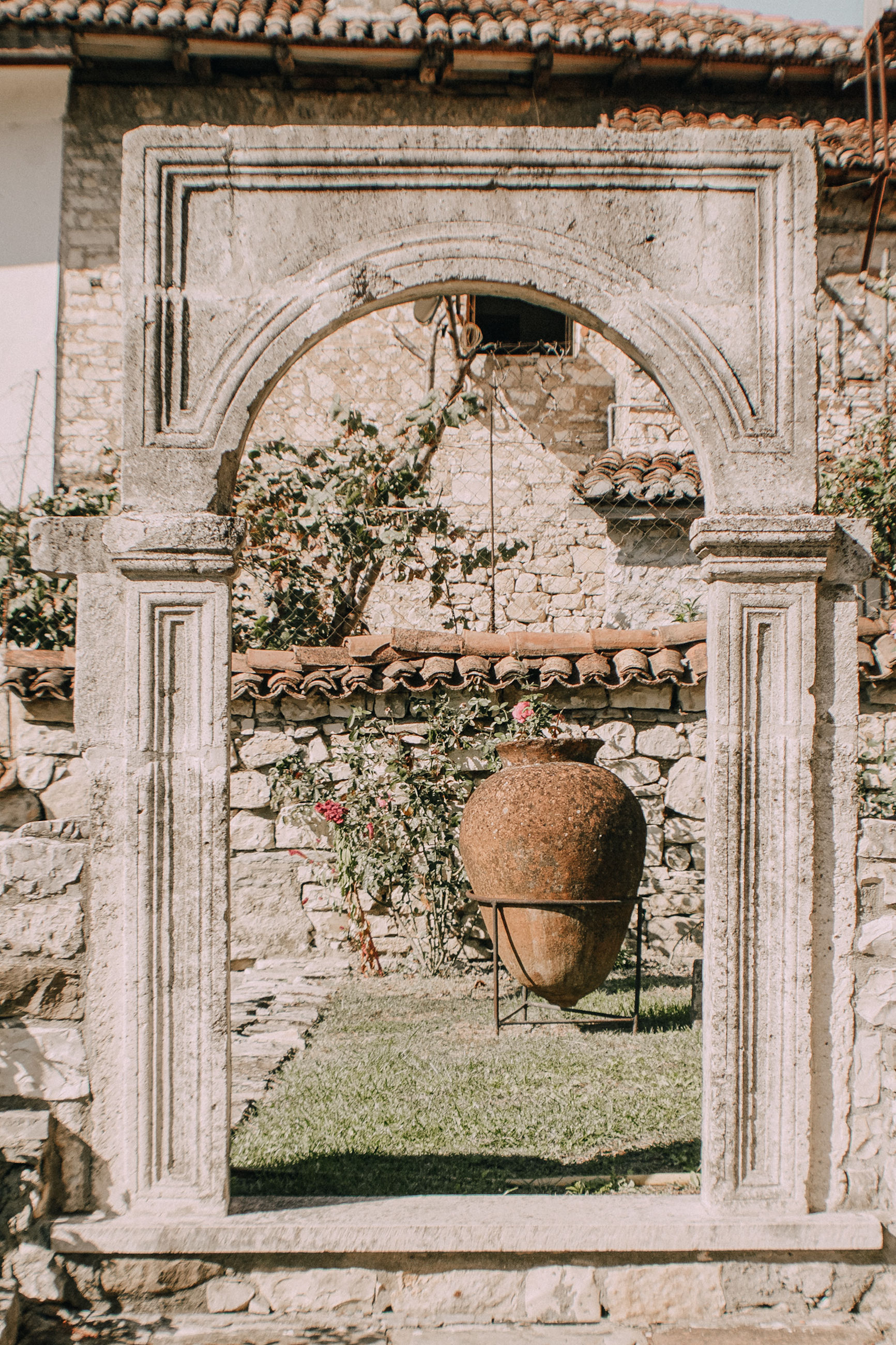 architecture, arch, built structure, building exterior, history, day, the past, no people, building, nature, outdoors, old, travel destinations, plant, ancient, tourism, travel, tree, wall, stone material, ornate, courtyard, electric lamp