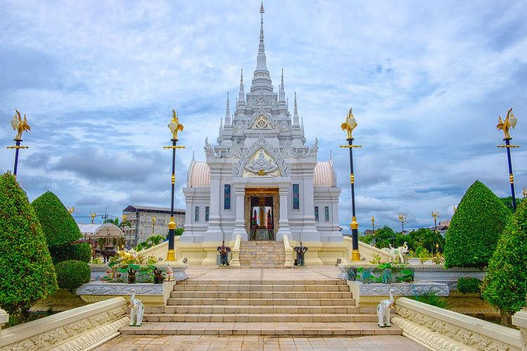Buddhist temple against cloudy sky
