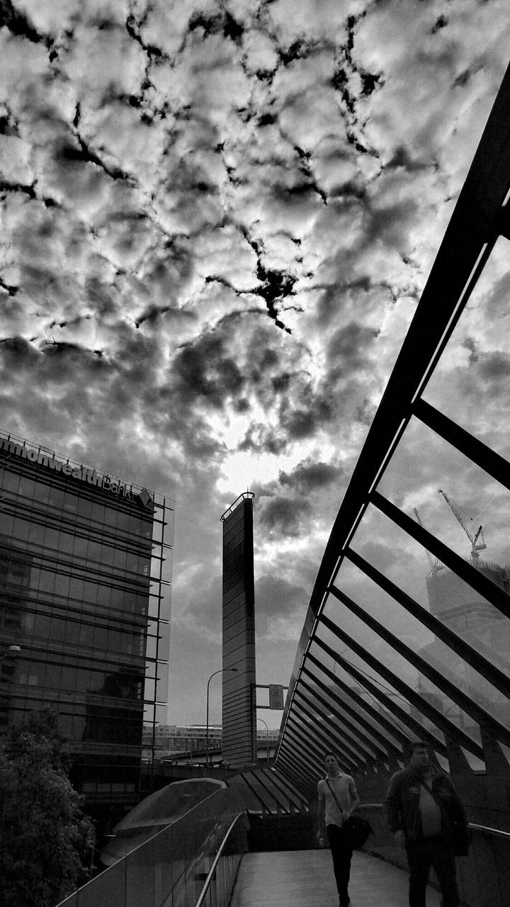 cloud - sky, architecture, built structure, sky, building exterior, low angle view, real people, outdoors, day, city, men, modern, tree, people
