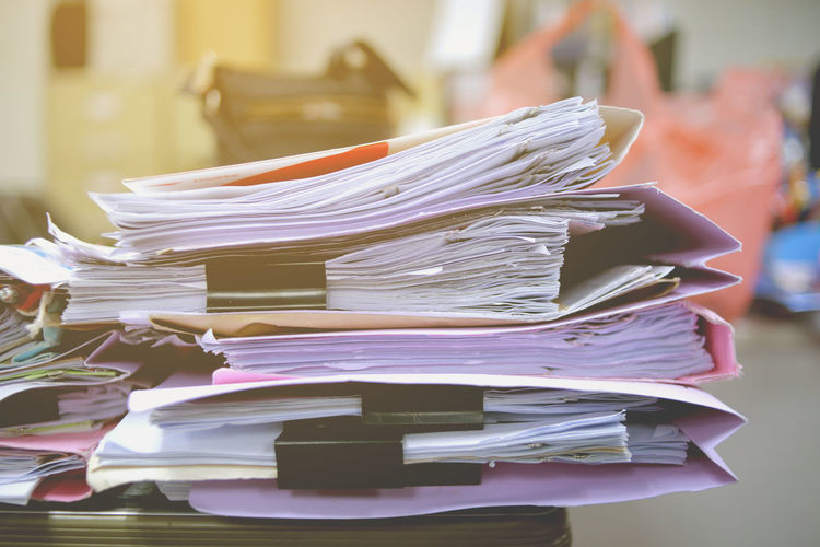Close-Up Of Files On Table At Office