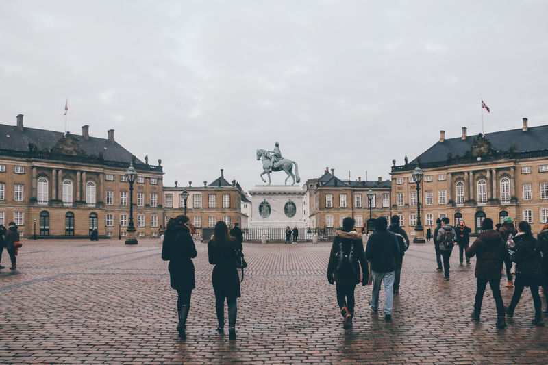 Amalienborg, home of the Danish royal family. Adult Adults Only Architectural Column Architecture Astronomical Clock Building Exterior Built Structure City Day History Ice Rink Large Group Of People Museum Outdoors People Sculpture Sky Statue Town Square Travel Travel Destinations