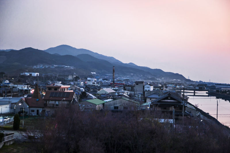 Ultimate Japan Coastal Cities Sea View Travel City Cityscape Coast Dawn Dawn Scenery Elevated View Hill Landscape Mountain Mountain Range Nature Outdoors Sky Town TOWNSCAPE Ultimate Japan