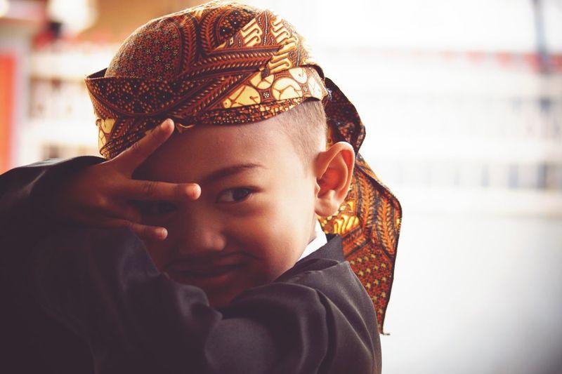 Close-up of cute boy in costume gesturing