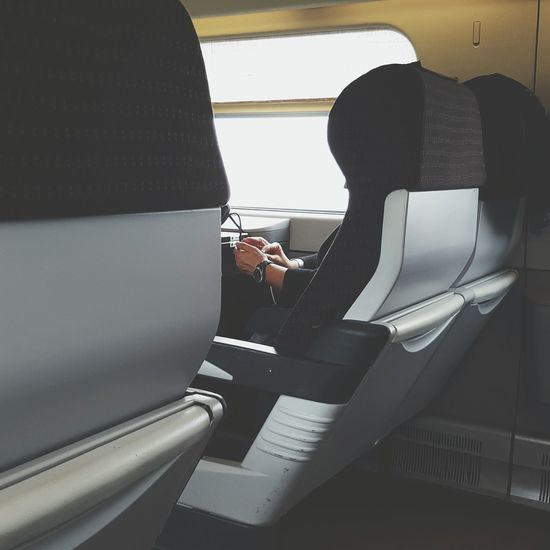 Cropped image of person traveling in train