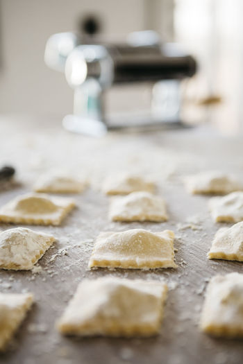 Making ravioli on a wooden table and tools At Home Ravioli Raw Wooden Table Close-up Dough Flour Food Food And Drink Foodphotography Foodporn Freshness Glutenfree Handmde Homemade Indoors  Italian Food Pasta Pasta Machine Preparation  Preparation  Ready-to-eat Selective Focus Table