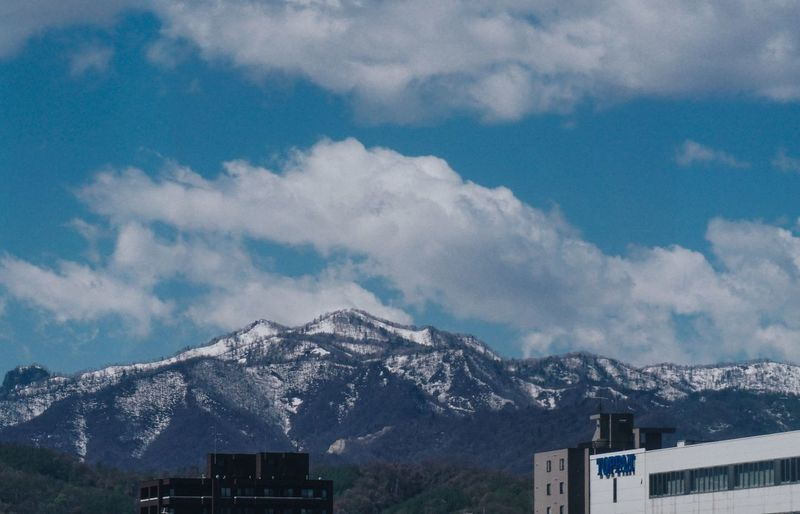 japan Mountain Sky Architecture Snow Building Exterior Cloud - Sky Mountain Range Built Structure Winter Day Outdoors No People Tranquility Nature Scenics Beauty In Nature Cold Temperature Landscape High Nature_collection Mountains Mountains And Sky Mountains And Clouds Mountains In Background Cityandmountain