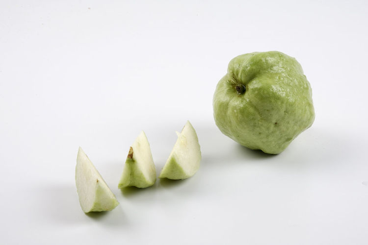 GREEN GUAVA ISOLATED ON WHITE Apple Apple - Fruit Close-up Copy Space Cut Out Food Food And Drink Freshness Fruit Granny Smith Apple Green Color Group Of Objects Healthy Eating Indoors  No People Ripe Snack Still Life Studio Shot Tropical Fruit Wellbeing White Background