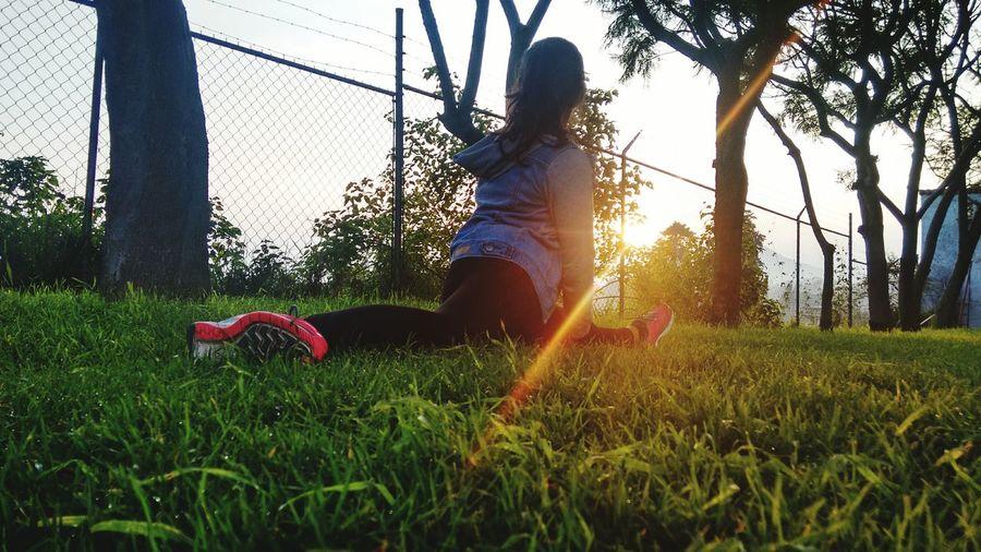 Woman doing splits on grass